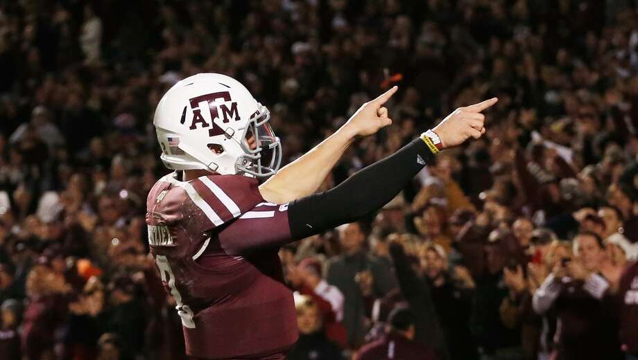 Johnny Manziel #2 of the Texas A&M Aggies celebrates a third quarter touchdown during their game against the Missouri Tigers at Kyle Field on November 24, 2012 in College Station, Texas.   (Scott Halleran / Getty Images)