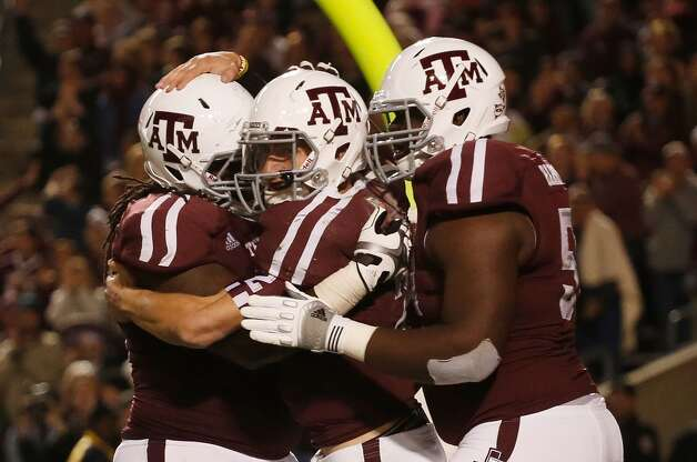 Johnny Manziel #2 of the Texas A&M Aggies (center) celebrates a third quarter touchdown with teammates during their game against the Missouri Tigers at Kyle Field on November 24, 2012 in College Station, Texas. Scott Halleran (Getty Images)