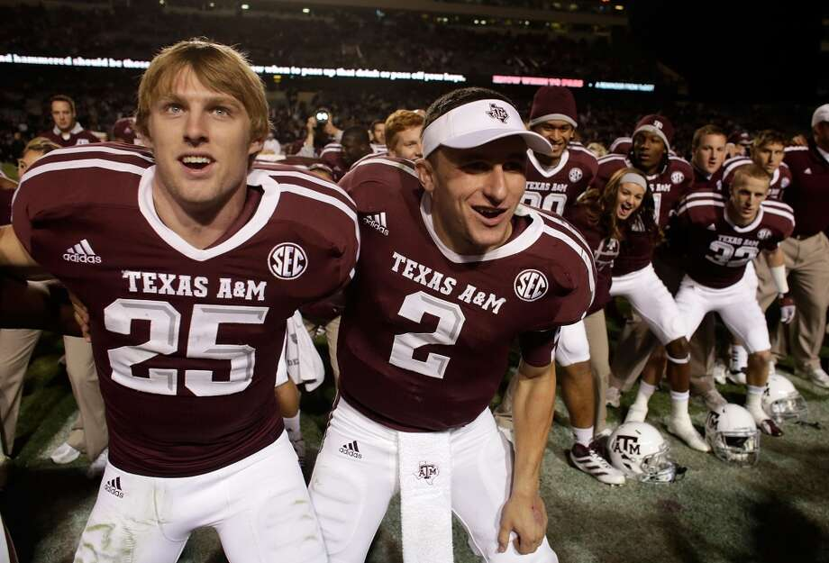Ryan Swope #25 and Johnny Manziel #2 of the Texas A&M Aggies celebrate with teammates after defeating the Missouri Tigers 59-29 at Kyle Field on November 24, 2012 in College Station, Texas.  (Scott Halleran / Getty Images)