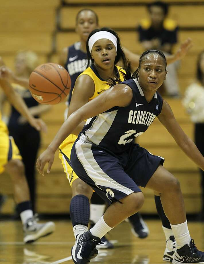 Cal's Brittany Boyd, (15) knocks the ball loose from the Hoyas Samisha Powell (23) as the California women went on to beat the Georgetown Hoyas in the championship game 72-56 in the Cal Classic basketball tournament at Haas Pavilion in Berkeley, Calif.  on Saturday Nov. 24, 2012. Photo: Michael Macor, The Chronicle