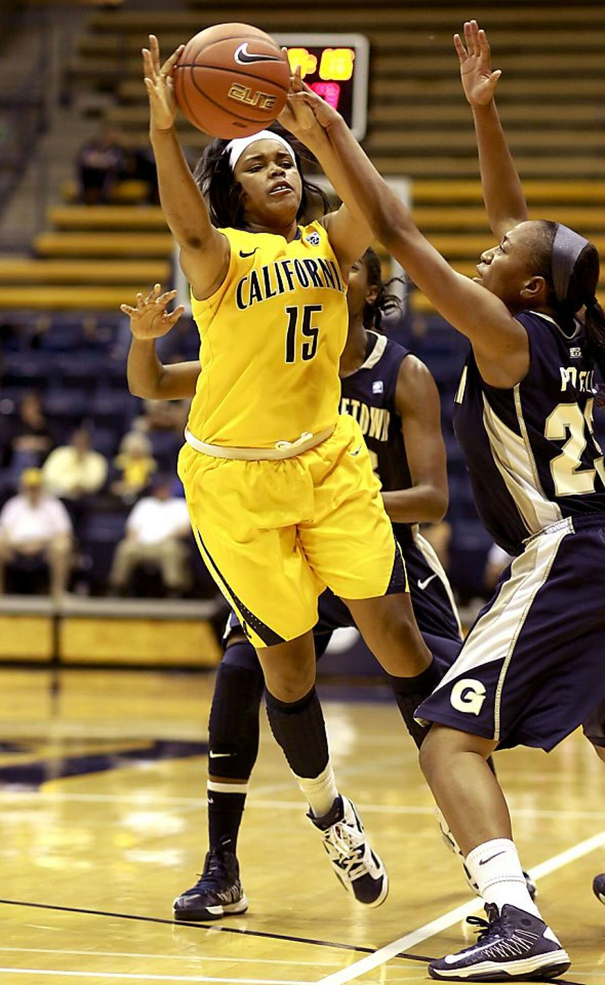 Cal's Brittany Boyd, (15) battles Brittany Horne, (33) and Samisha Powell during the first half, as the California women take on the Georgetown Hoyas in the championship game of the Cal Classic basketball tournament at Haas Pavilion in Berkeley, Calif. on Saturday Nov. 24, 2012.
