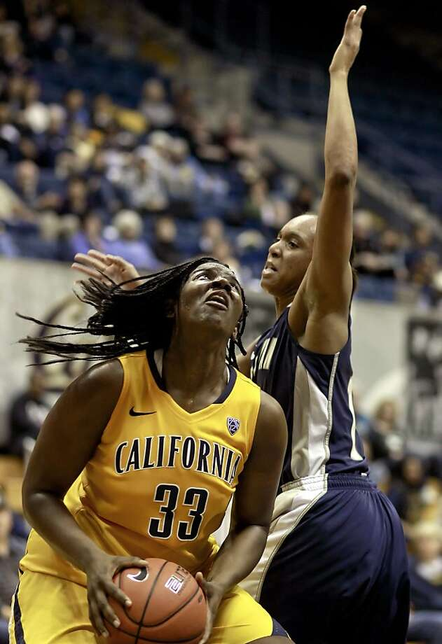 Cal's Talia Caldwell, (33) goes up against the Hoyas' Andrea Whoite, (11) as the California women went on to beat the Georgetown Hoyas in the championship game 72-56 in the Cal Classic basketball tournament at Haas Pavilion in Berkeley, Calif.  on Saturday Nov. 24, 2012. Photo: Michael Macor, The Chronicle