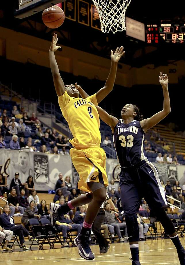 Cal's Afure Jemerigbe, (20) is fouled by the Hoyas' Brittany Horne (33)  as the California women went on to beat the Georgetown Hoyas in the championship game 72-56 in the Cal Classic basketball tournament at Haas Pavilion in Berkeley, Calif.  on Saturday Nov. 24, 2012. Photo: Michael Macor, The Chronicle