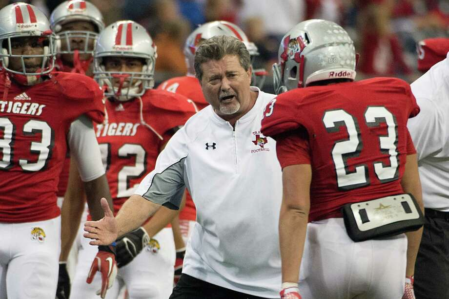 Travis head coach Randy Cunningham celebrates a touchdown run by running back Steven Oliver. Photo: Smiley N. Pool, Houston Chronicle / © 2012  Houston Chronicle