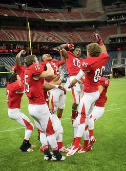 Travis players celebrate their victory over Deer Park in Class 5A Division I area round high school football playoff action at Reliant Stadium Saturday, Nov. 24, 2012, in Houston.  Smiley N. Pool / Houston Chronicle ) Photo: Smiley N. Pool, Houston Chronicle / © 2012  Houston Chronicle