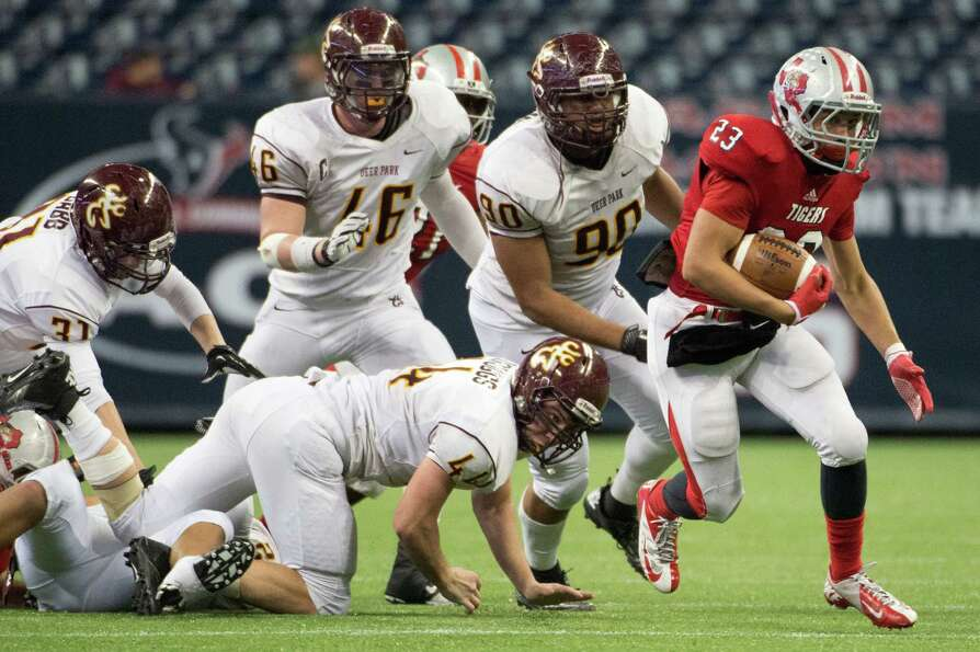 Travis running back Steven Oliver breaks away from the Deer Park defense on a long touchdown run dur