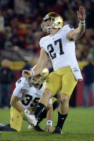 LOS ANGELES, CA - NOVEMBER 24:  Kyle Brindza #27 of the Notre Dame Fighting Irish watches his fourth field goal for a 19-13 lead over the USC Trojans at Los Angeles Memorial Coliseum on November 24, 2012 in Los Angeles, California.  Notre Dame would win 22-13. Photo: Harry How, Getty Images / 2012 Getty Images