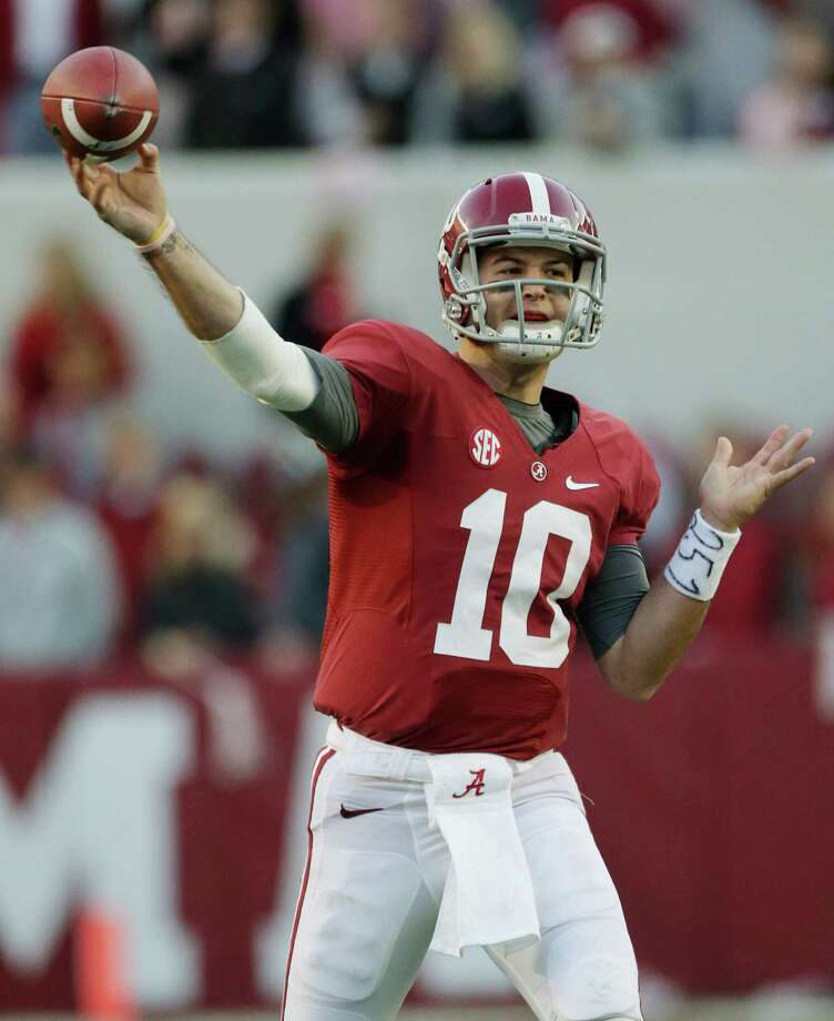 Alabama quarterback AJ McCarron (10) looks for a receiver during the first half of a NCAA college football game against Auburn at Bryant-Denny Stadium in Tuscaloosa, Ala., Saturday, Nov. 24, 2012. (AP Photo/Dave Martin) Photo: Dave Martin