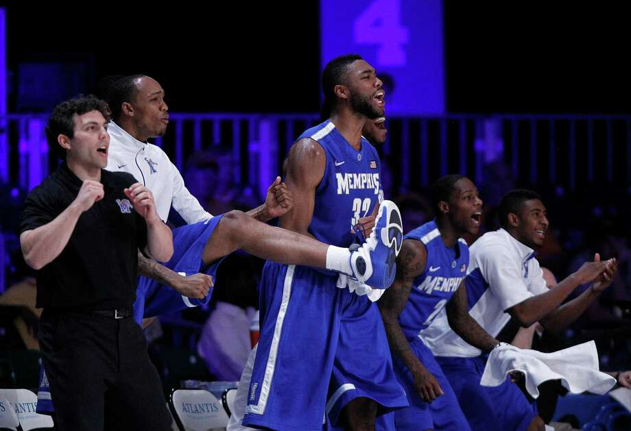 Memphis coach Josh Pastner and players from left, Ferrakohn Hall, Stan Simpson (32), Antonio Barton (2) and Anthony Cole (12) react to a Memphis basket late in the second half of their 52-47 victory over Northern Iowa in an NCAA college basketball game at the Battle 4 Atlantis tournament, Saturday, Nov. 24, 2012 in Paradise Island,  Bahamas.  (AP Photo/John Bazemore) Photo: John Bazemore