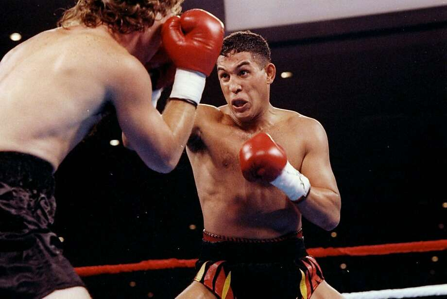 "It was reported that ex-boxer Hector ""Macho"" Camacho died after being taken off life support following a gun shot wound to the face November 24, 2012 in San Juan, Puerto Rico. 1 Aug 1992:  Boxer Hector Camacho (right) trades blows with Eddie Van Kirk. Mandatory Credit: Holly Stein  /Allsport Photo: Holly Stein, Getty Images"