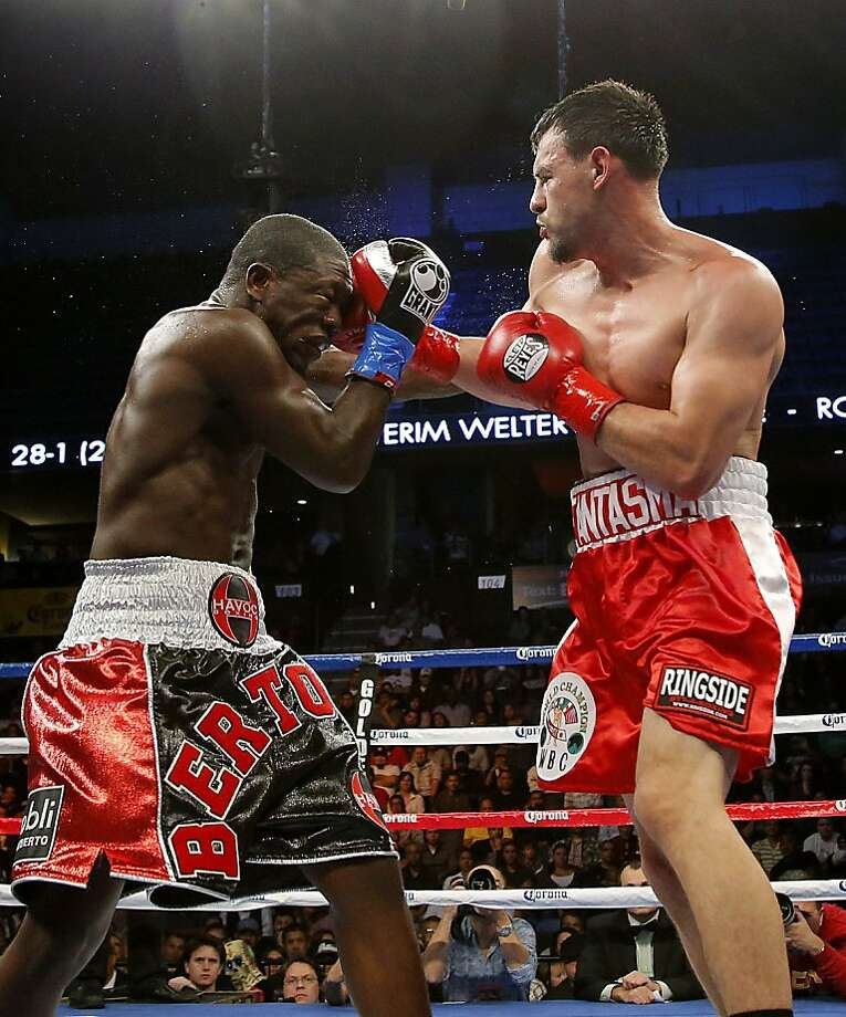 Robert Guerrero, right, lands a punch to the face of Andre Berto in the fourth round of a WBC interim welterweight title fight in Ontario, Calif., Saturday, Nov. 24, 2012. Guerrero won by unanimous decision. (AP Photo/Jae C. Hong) Photo: Jae C. Hong, Associated Press
