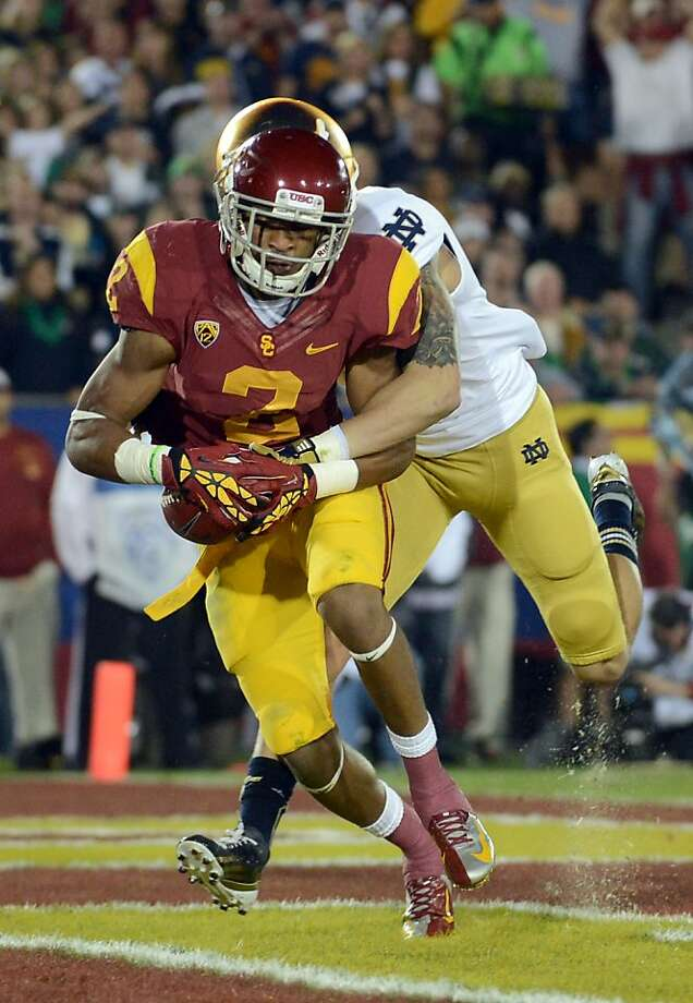 LOS ANGELES, CA - NOVEMBER 24:  Robert Woods #2 of the USC Trojans makes a catch for a touchdown in front of Bennett Jackson #2 of the Notre Dame Fighting Irish to trail 10-7 to the Notre Dame Fighting Irish at Los Angeles Memorial Coliseum on November 24, 2012 in Los Angeles, California.  (Photo by Harry How/Getty Images) Photo: Harry How, Getty Images