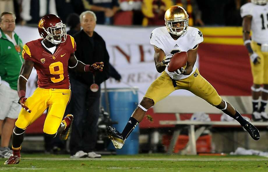 Notre Dame cornerback KeiVarae Russell makes an interception in front of USC receiver Marquise Lee (9) in the second quarter at the Los Angeles Coliseum on Saturday, November 24, 2012, in Los Angeles, California. (Wally Skalij/Los Angeles Times/MCT) Photo: Wally Skalij, McClatchy-Tribune News Service