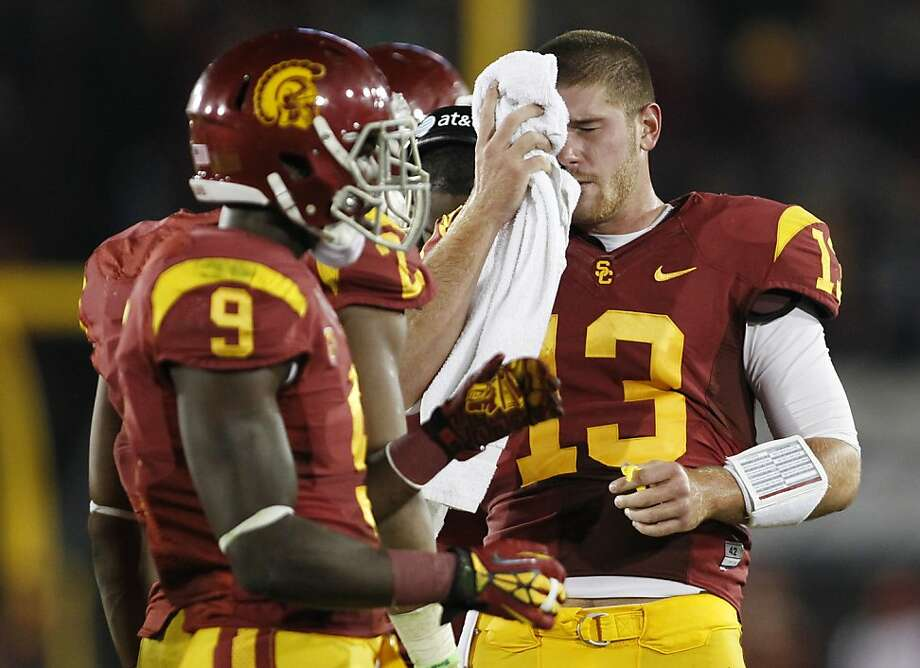 Southern California quarterback Max Wittek, right, wipes his face with a towel as wide receiver Marqise Lee (9) stands near him during a stop during in play in the second half against Notre Dame in an NCAA college football game, Saturday, Nov. 24, 2012, in Los Angeles. Notre Dame won 22-13. (AP Photo/Danny Moloshok) Photo: Danny Moloshok, Associated Press