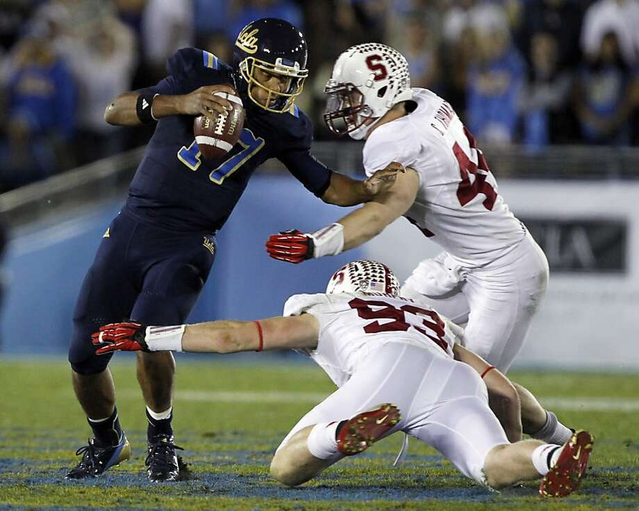 Chase Thomas (right) and Trent Murphy sack UCLA's Brett Hundley. Photo: Alex Gallardo, Associated Press