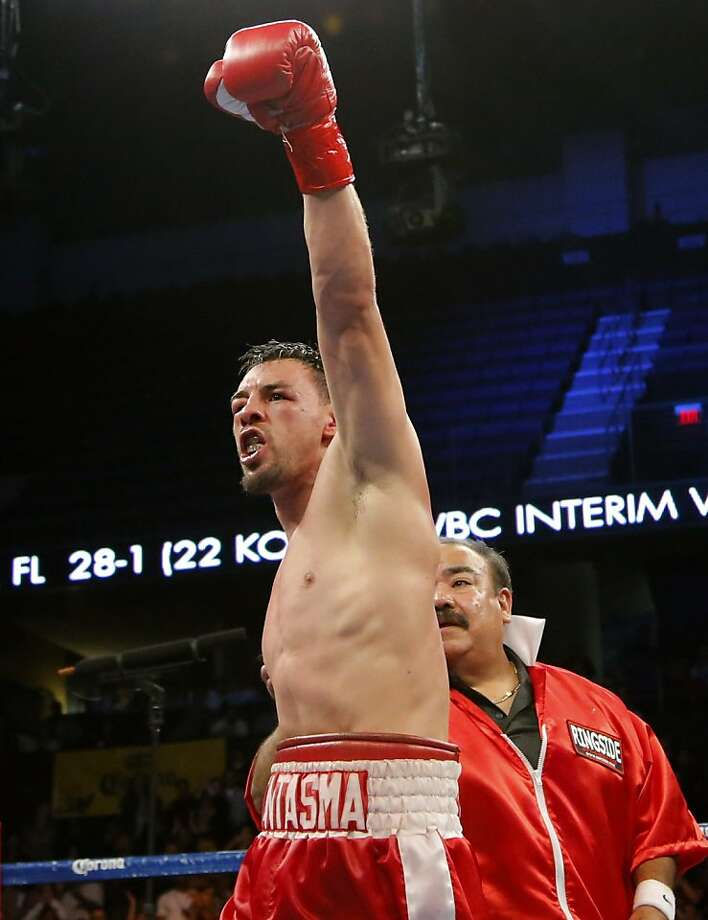 Robert Guerrero raises his arm after the final round of a WBC interim welterweight title fight against Andre Berto in Ontario, Calif., Saturday, Nov. 24, 2012. Guerrero won by unanimous decision. (AP Photo/Jae C. Hong) Photo: Jae C. Hong, Associated Press