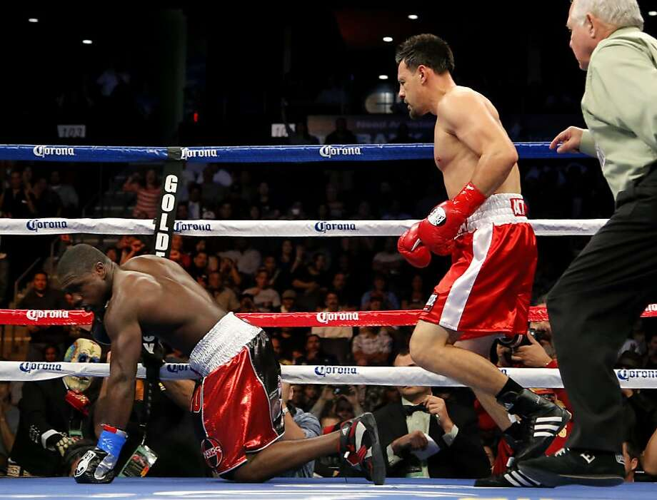 Robert Guerrero, right, knocks down Andre Berto during the second round of a WBC interim welterweight title fight in Ontario, Calif., Saturday, Nov. 24, 2012. Guerrero won by unanimous decision. (AP Photo/Jae C. Hong) Photo: Jae C. Hong, Associated Press