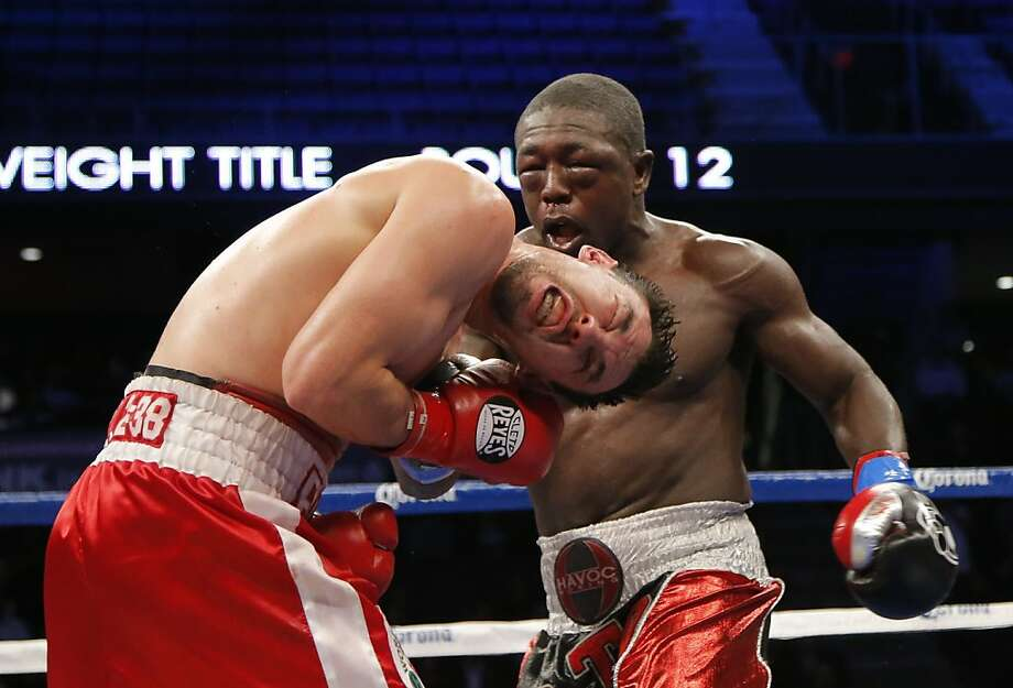 Robert Guerrero, left, takes a punch from Andre Berto in the 12th round of a WBC interim welterweight title fight in Ontario, Calif., Saturday, Nov. 24, 2012. Guerrero won by unanimous decision after the 12th round. (AP Photo/Jae C. Hong) Photo: Jae C. Hong, Associated Press