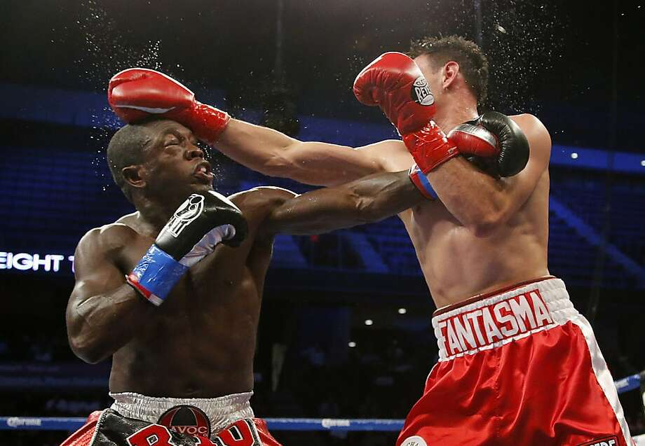 Robert Guerrero, right, and Andre Berto trade punches in the fourth round of a WBC interim welterweight title fight in Ontario, Calif., Saturday, Nov. 24, 2012. (AP Photo/Jae C. Hong) Photo: Jae C. Hong, Associated Press