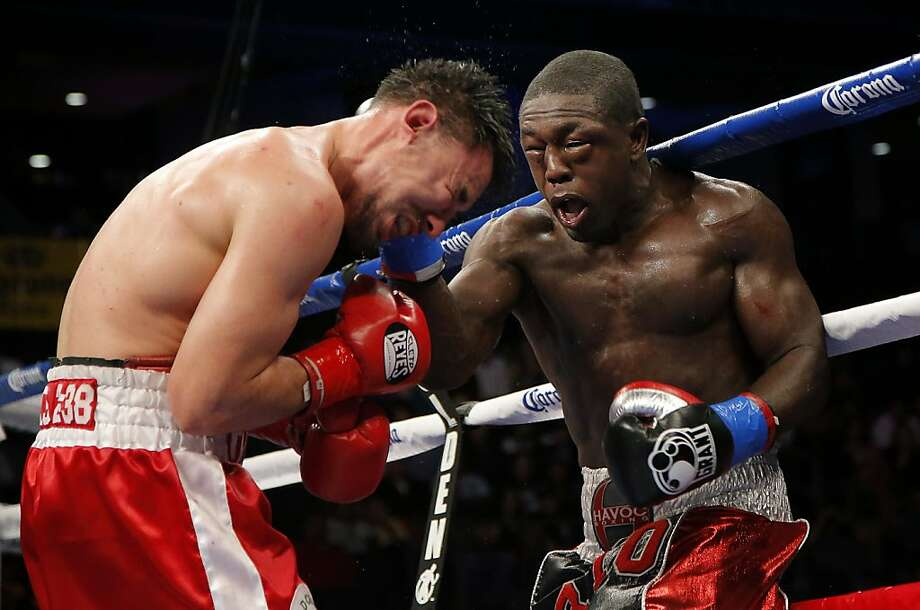 Robert Guerrero, left, takes a punch from Andre Berto in the 10th round of a WBC interim welterweight title fight in Ontario, Calif., Saturday, Nov. 24, 2012. (AP Photo/Jae C. Hong) Photo: Jae C. Hong, Associated Press