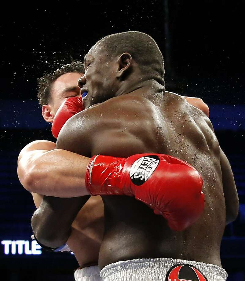 Andre Berto, front, holds Robert Guerrero in the sixth round of a WBC interim welterweight title fight in Ontario, Calif., Saturday, Nov. 24, 2012. Guerrero won by unanimous decision. (AP Photo/Jae C. Hong) Photo: Jae C. Hong, Associated Press
