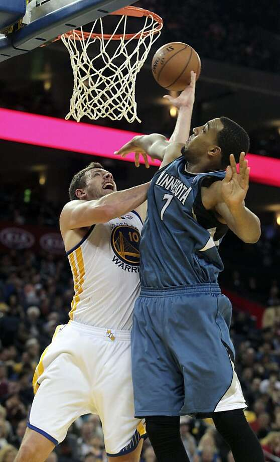 Golden State Warriors' David Lee (10) drives to the basket against the Minnesota Timberwolves' Derrick Williams (7) in the second half of an NBA basketball game in Oakland, Calif., Saturday, Nov. 24, 2012. The Warriors won 96-85. (AP Photo/Mathew Sumner) Photo: Mathew Sumner, Associated Press