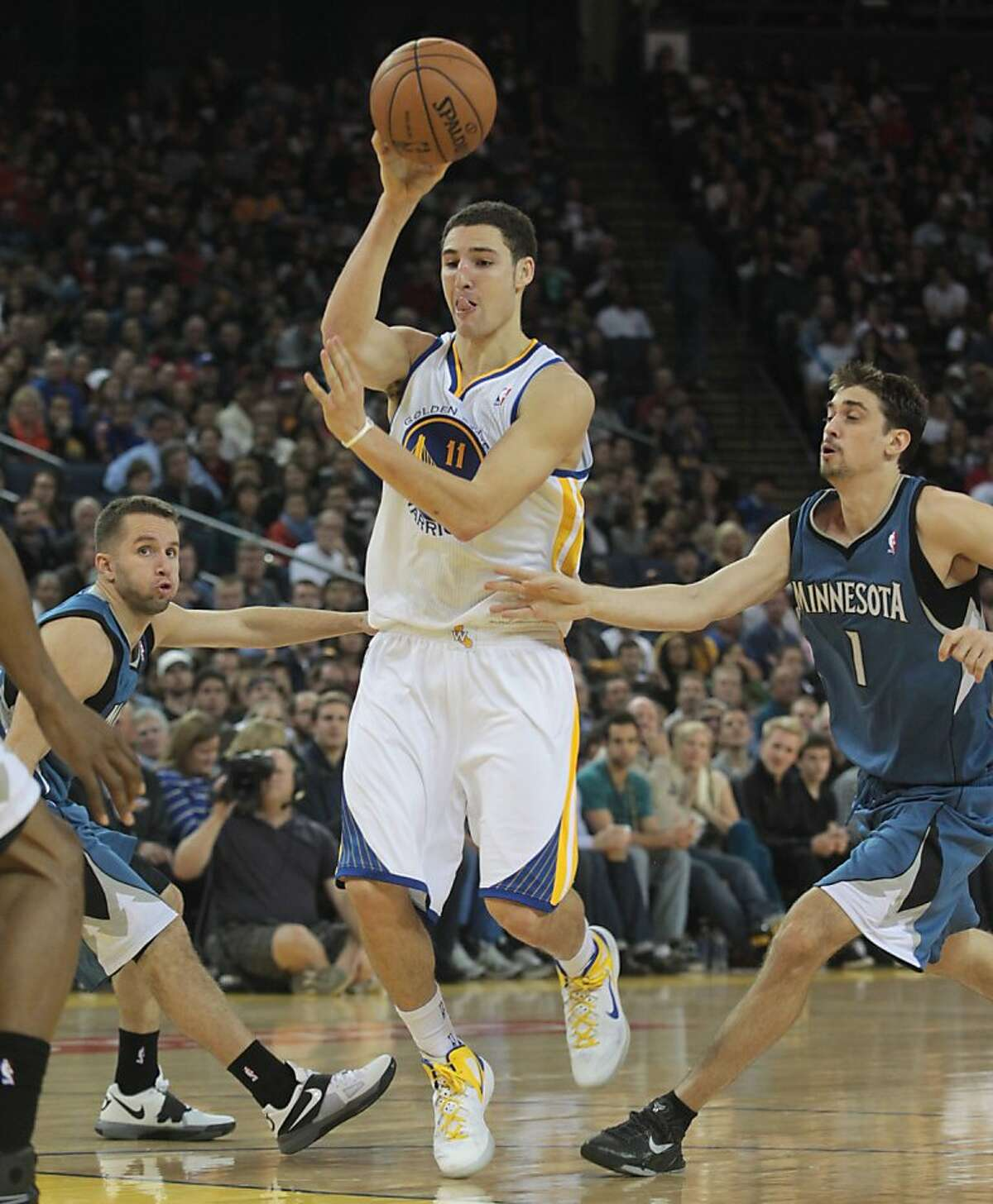 Golden State Warriors' Klay Thompson (11) delivers a no look pass against the Minnesota Timberwolves in the second half of an NBA basketball game in Oakland, Calif., Saturday, Nov. 24, 2012. The Warriors won 96-85. (AP Photo/Mathew Sumner)