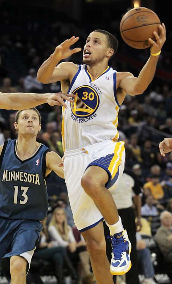 Golden State Warriors' Stephen Curry (30) drives to the basket against the Minnesota Timberwolves in the second half of an NBA basketball game in Oakland, Calif., Saturday, Nov. 24, 2012. The Warriors won 96-85. (AP Photo/Mathew Sumner) Photo: Mathew Sumner, Associated Press