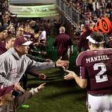 Texas A&M quarterback Johnny Manziel (2) is greeted by fans as he runs off the field after the Aggies beat Missouri, Saturday, Nov. 24, 2012, in Kyle Field in College Station.