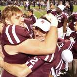 Texas A&M defensive lineman Spencer Nealy (99) hugs Texas A&M quarterback Johnny Manziel (2) after beating Missouri, Saturday, Nov. 24, 2012, in Kyle Field in College Station.
