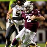 Texas A&M quarterback Johnny Manziel (2) scrambles for extra yards in the Missouri defense during the first quarter of a NCAA football game, Saturday, Nov. 24, 2012, in Kyle Field in College Station.