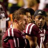 Texas A&M quarterback Johnny Manziel (2) talks to teammates on the bench during the second quarter of a NCAA football game against Missouri, Saturday, Nov. 24, 2012, in Kyle Field in College Station.