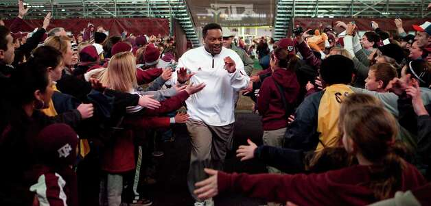 Texas A&M head coach Kevin Sumlin is greeted by fans after the Aggies beat Missouri, Saturday, Nov. 24, 2012, in Kyle Field in College Station. Photo: Nick De La Torre, Houston Chronicle / © 2012  Houston Chronicle