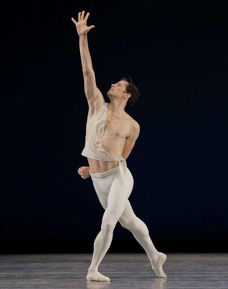 Robert Fairchild as Apollo in Apollo Choreography ©The George Balanchine Trust New York City Ballet SPAC - 7/14/11 - Evening Credit Photo: ©2011 Paul Kolnik Photo: Paul Kolnik