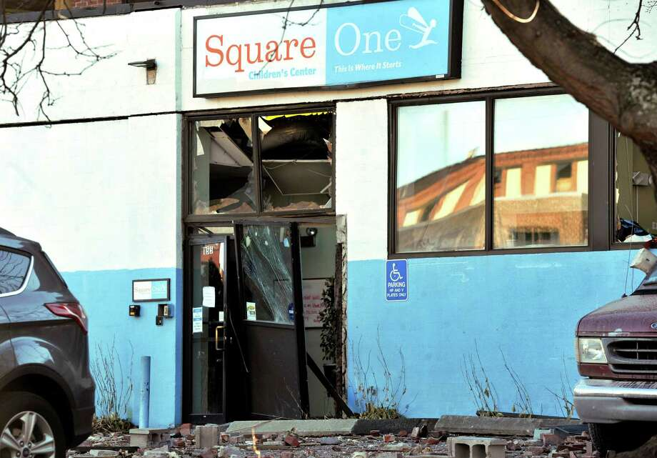 A day care next door to a gas explosion that leveled a strip club Friday evening is seen in Springfield, Mass., Saturday, Nov. 24, 2012. Investigators are trying to figure out what caused the Friday evening blast that could be heard for miles, and that left a large hole in the ground where the multistory brick building housing Scores Gentleman's Club once stood. Photo: Jessica Hill, AP / FR125654 AP