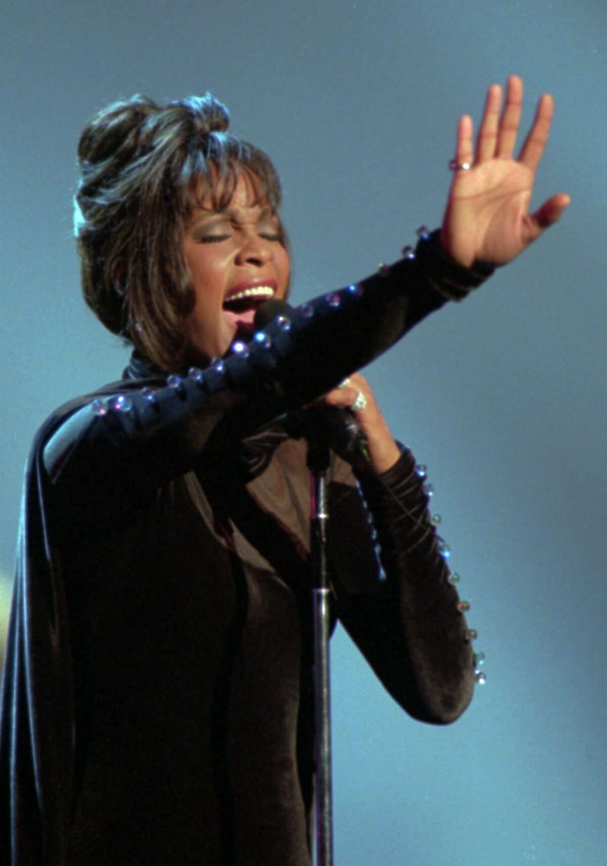 ADVANCE FOR SUN. FEB. 27--FILE- Singer Whitney Houston performs at the American Music Awards in Los Angeles on Feb. 7, 1994. Houston has been nominated for four Grammy awards, including album-of-the-year for