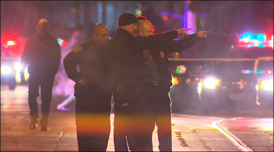 Seattle Police officers investigate at the scene of a shooting outside a nightclub early Sunday, Nov. 25, 2012. Photo: KOMO News