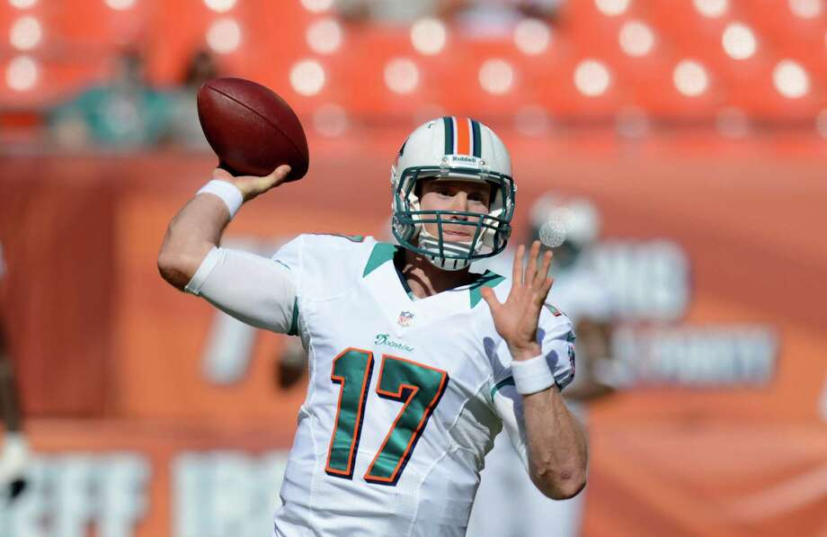 Miami Dolphins quarterback Ryan Tannehill throws during warmups before the start of an NFL football game against the Seattle Seahawks, Sunday, Nov. 25, 2012 in Miami. Photo: AP