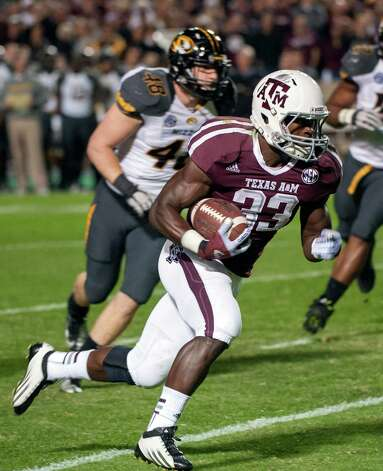Texas A&M's Christine Michael (33) runs around Missouri's Andrew Wilson (48) for a touchdown during the first quarter of an NCAA college football game on Saturday, Nov. 24, 2012, in College Station, Texas. (AP Photo/Dave Einsel) Photo: Dave Einsel, FRE