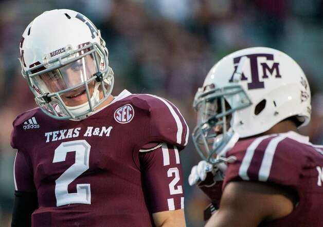 Texas A&M quarterback Johnny Manziel (2) jokes with teammate Ben Malena, right, before an NCAA college football game against Missouri, Saturday, Nov. 24, 2012, in College Station, Texas. (AP Photo/Dave Einsel) Photo: Dave Einsel, FRE