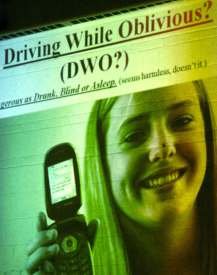"""A slide presentation depicting the tragic consequences of texting while driving delivered a powerful message to area students, their parents and others on hand during """"Survive The Drive,"""" hosted Nov. 8 at Sherman School by the ShermanTraffic Safety Work Group and the Sherman PTO Photo: Norm Cummings"""