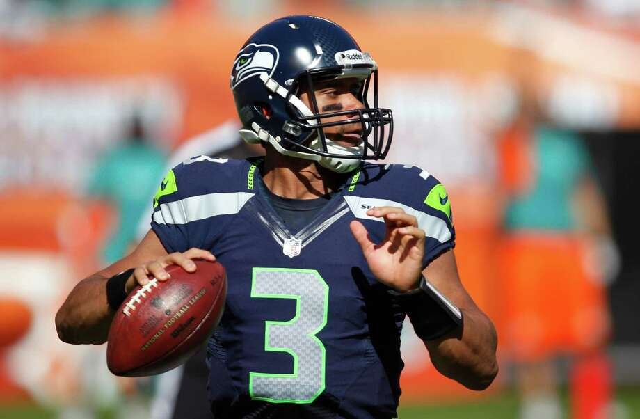 Seattle Seahawks quarterback Russell Wilson looks to pass during the first half of an NFL football game against the Miami Dolphins, Sunday, Nov. 25, 2012 in Miami. Photo: AP
