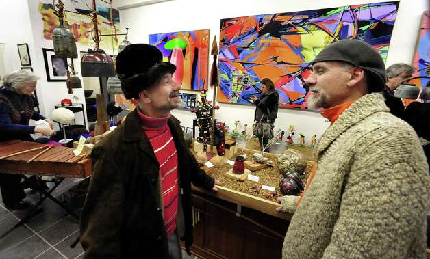 Michael Seri, left, and Frank Kara talk at the opening of their new gallery show at Pop Up Art Bethel, Saturday, Nov. 24, 2012. Photo: Michael Duffy / The News-Times