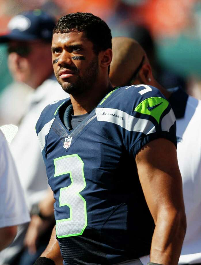 Seattle Seahawks quarterback Russell Wilson stands on the sidelines  during the first half of an NFL football game against the Miami Dolphins, Sunday, Nov. 25, 2012 in Miami. Photo: AP