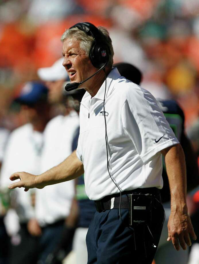 Seattle Seahawks head coach Pete Carroll gestures during the first half of an NFL football game against the Miami Dolphins, Sunday, Nov. 25, 2012 in Miami . AP Photo/Gerry Broome) Photo: AP