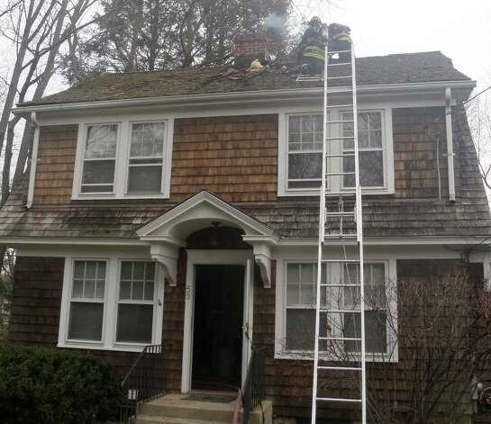 Firefighters scale the roof of a Washington Avenue home where chimney embers apparently sparked a roof fire Sunday morning. Westport CT 11/25/12 Photo: Westport Fire Department / Westport News contributed
