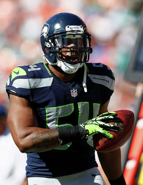 Seattle Seahawks middle linebacker Bobby Wagner (54) runs with the ball during the first half of an