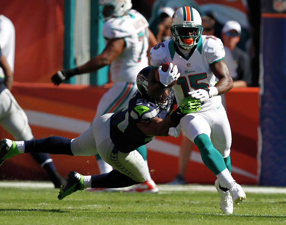 Seattle Seahawks middle linebacker Bobby Wagner (54) tackles Miami Dolphins wide receiver Davone Bess (15), during the first half of an NFL football game Sunday, Nov. 25, 2012 in Miami. Photo: AP