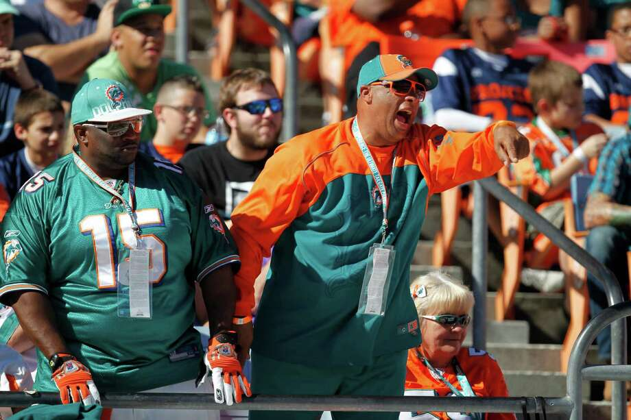 Miami Dolphins fans cheer during the first half of an NFL football game Sunday, Nov. 25, 2012 in Miami . Photo: AP
