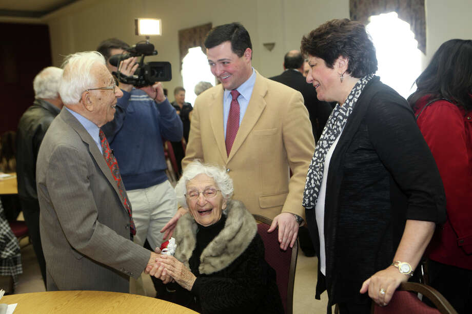 Trumbull First Selectman Tim Herbst, center,  congratulates John and Ann Betar, of Fairfield, on their 80th anniversary during a celebration at St. Nicholas Antiochian Orthodox Church, in Bridgeport, Conn. on Sunday, November 25, 2012. Photo: BK Angeletti, B.K. Angeletti / Connecticut Post freelance B.K. Angeletti